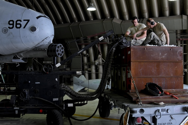 U.S. Air force Staff Sgt. Matthew Mayo and Tech. Sgt. Christopher Leslie, 51st Aircraft Maintenance Squadron weapons load crew members, load ammunition onto an A-10 Thunderbolt during Exercise Beverly Herd 17-2 at Osan Air Base, Republic of Korea, May 5, 2017.  The no-notice exercise challenged the tradition of planning exercises weeks or months in advance, allowing wing leadership a view of how personnel would react in a real-world situation. (U.S. Air Force photo by Airman 1st Class Gwendalyn Smith)