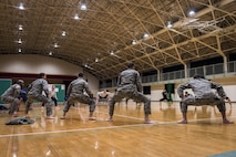 U.S. and Japanese Airmen stretch prior to learning a traditional Japanese dance during a 10-day U.S.-Japan Bilateral Career Training, at Chitose Air Base, Japan, April 12, 2017. Over the next hour and a half, the Koku-Jieitai and U.S. Airmen from Misawa Air Base, Japan, danced while learning more about each other's cultural background helping to increase the two-nation's interoperability. Cultural exchanges like this dance strengthen the U.S.-Japan security alliance by humanizing each nation's service members bringing them closer as allies and friends. Koku-Jieitai is the traditional term for Japan Air Self Defense Force used by the Japanese. (U.S. Air Force photo by Tech. Sgt. Benjamin W. Stratton)