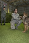 Koku-Jieitai Staff Sgt. Shunsuke Yorozu, left, a 2nd Air Wing Security Forces member, waves a toy as U.S. Air Force Staff Sgt. Ebony Jenkins, center, a 35th Security Forces Squadron member, holds a military working dog during a training practice during a 10-day U.S.-Japan Bilateral Career Training at Chitose Air Base, Japan, April 19, 2017. Jenkins worked side-by-side with Yorozu learning how the Koku-Jieitai executes their security mission. She traveled from Misawa Air Base, Japan, with nine other U.S. Airmen for the bilateral exchange event specifically designed to bring the two nation's air forces closer as allies and friends. Koku-Jieitai is the traditional term for Japan Air Self Defense Force used by the Japanese. (U.S. Air Force photo by Tech. Sgt. Benjamin W. Stratton)