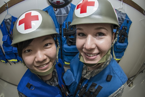 """Koku-Jieitai Senior Airman Minori Utano, left, a 2nd Air Wing Medical Squadron medical administration technician, poses for a photo with her counterpart, U.S. Air Force Tech. Sgt. Jessica Nienheuser, right, the 35th Medical Support Squadron patient administration section chief, during a 10-day U.S.-Japan Bilateral Career Training at Chitose Air Base, Japan, April 19, 2017. Nienheuser joined nine other U.S. Airmen, April 11-20, for the bilateral exchange event that brought the two nations closer as allies and friends. The technical sergeant said she learned a lot from the Japanese saying she was specifically impressed by how their senior leaders work right along with their Airmen. """"I can see they lead by example and I can take that as a strength because it works for them, because their subordinates respect them,"""" she said. Koku-Jieitai is the traditional term for Japan Air Self Defense Force used by the Japanese. (U.S. Air Force photo by Tech. Sgt. Benjamin W. Stratton)"""