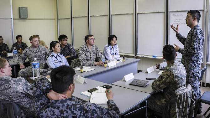 Koku-Jieitai Senior Airman Takashi Shibuya, a 2nd Air Wing Armament Maintenance Squadron armament technician, explains his view of leadership with U.S. and other Japanese Airmen during a 10-day U.S.-Japan Bilateral Career Training at Chitose Air Base, Japan, April 19, 2017. The U.S. and Japanese participants broke out into three groups, each allowed 30 minutes to discuss their top three leadership traits and then present their findings with the rest of the participants. Koku-Jieitai is the traditional term for Japan Air Self Defense Force used by the Japanese. (Japanese Air Self-Defense Force photo by Chief Master Sgt. Katsuaki Imazeki)