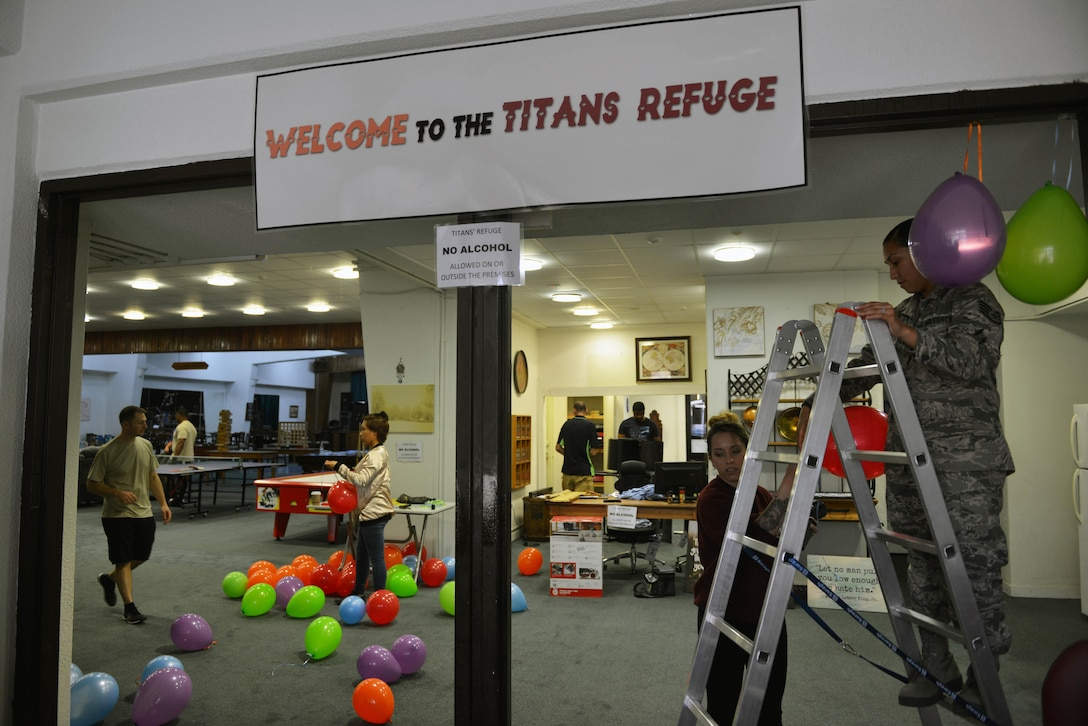 U.S. Airmen prepare the Titans' Refuge Ministry Center for a grand opening ceremony May 4, 2017, at Incirlik Air Base, Turkey. The ceremony will take place on May 5, and feature a Cinco de Mayo theme with a live musical performance. (U.S. Air Force photo by Senior Airman John Nieves Camacho)