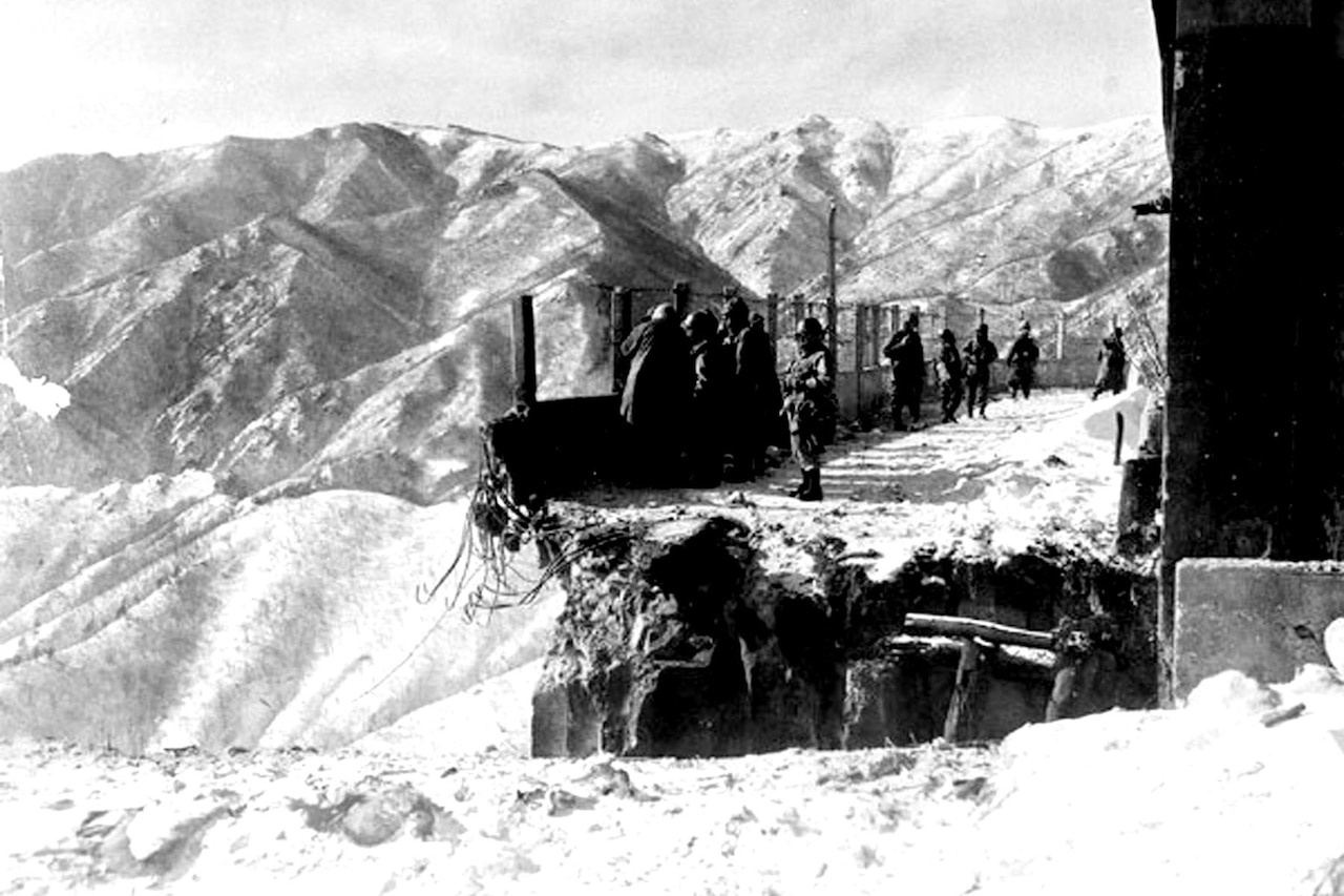 This blown bridge at Funchilin Pass blocked the only way out for U.S. and British forces withdrawing from the Chosin Reservoir in North Korea. Air Force C-119 Flying Boxcars dropped portable bridge sections to span the chasm in December 1950, allowing men and equipment to reach safety. Air Force photo