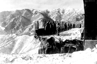 This blown bridge at Funchilin Pass blocked the only way out for U.S. and British forces withdrawing from the Chosin Reservoir in North Korea during the Korean War. Air Force C-119 Flying Boxcars dropped portable bridge sections to span the chasm in December 1950, allowing men and equipment to reach safety. Air Force photo