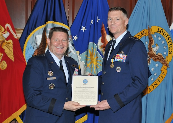 Air Force Gen. Robin Rand (left), Commander, Air Force Global Strike Command, and the service component commander to U.S. Strategic Command, presided over the retirement of DLA Director Air Force Lt. Gen. Andy Busch at DLA Headquarters, Fort Belvoir, Virginia May 4. The two are fellow graduates of the U.S. Air Force Academy Class of 1979. At the ceremony, Rand presented Busch with the Defense Distinguished Service Medal.
