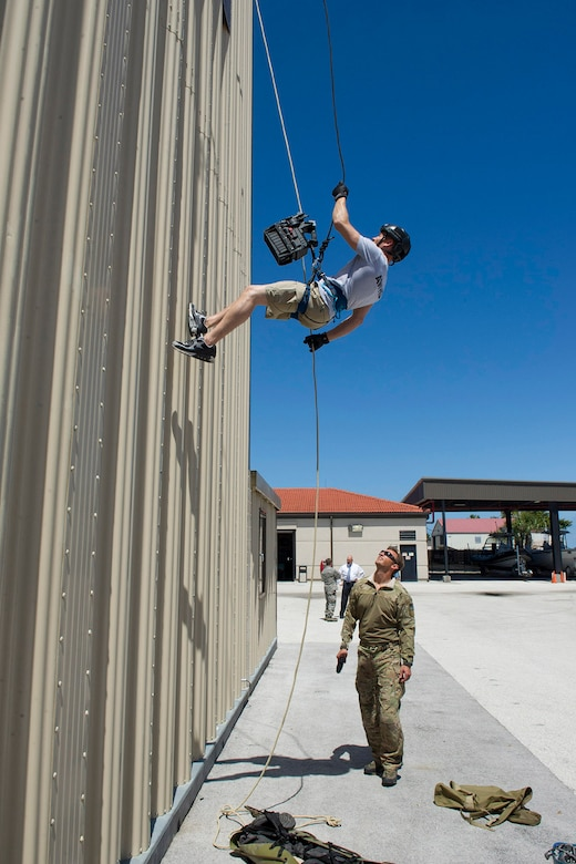 Tech. Sgt. Kyle Minshew, 308th Rescue Squadron pararescueman, guides American Ninja Warrior star Brent Steffensen as he rappels down the unit's training tower April 21, 2017 at Patrick Air Force Base, Florida. Steffensen visited the base as part of the Alpha Warrior Military Tour. (U.S. Air Force photo/Phillip Sunkel)