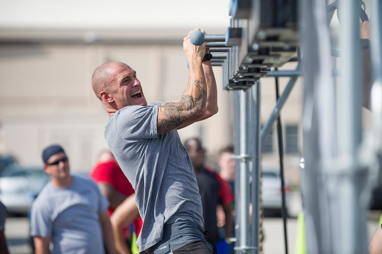 Master Sgt. William Posch, 308th Rescue Squadron pararescueman, works his way through the Alpha Warrior Course April 22, 2017 set up at Patrick Air Force Base, Florida. American Ninja Warrior stars Barclay Stockett and Brent Steffensen hosted the event which included a variety of obstacles to test competitors' upper body strength and agility. Close to 40 people stepped up to the challenge while a crowd of spectators cheered them on. (U.S. Air Force photo/Phillip Sunkel)