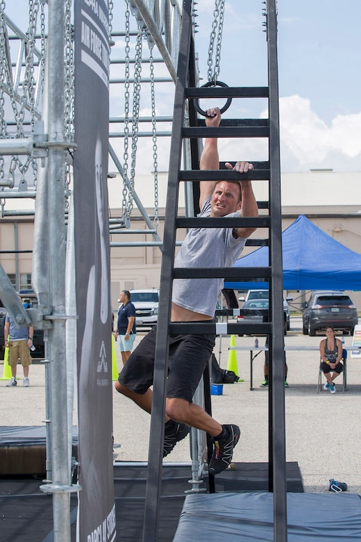 Tech. Sgt. Kyle Minshew, 308th Rescue Squadron pararescueman, puts his upper body strength to the test as he works his way through the Alpha Warrior Course April 22, 2017 set up at Patrick Air Force Base, Florida. Minshew placed second in the competition out of 37 competitors. (U.S. Air Force photo/Phillip Sunkel)