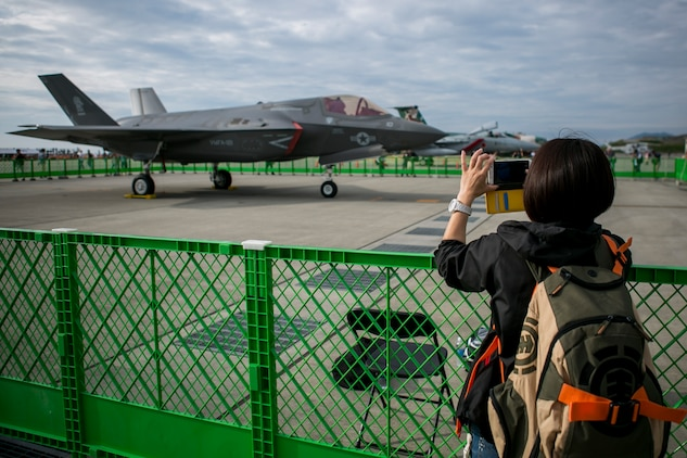 A Japanese local takes a picture of a U.S. Marine Corps F-35B Lightning II static display during the 41st Japan Maritime Self-Defense Force – Marine Corps Air Station Iwakuni Friendship Day at MCAS Iwakuni, Japan, May 5, 2017.Since 1973, MCAS Iwakuni has held a single-day air show designed to foster positive relationships and offer an elevating experience that displays the communal support between the U.S. and Japan. The air show also encompassed various U.S. and Japanese static aircraft displays, aerial performances and demonstrations, food and entertainment. (U.S. Marine Corps photo by Lance Cpl. Tiana Boyd)