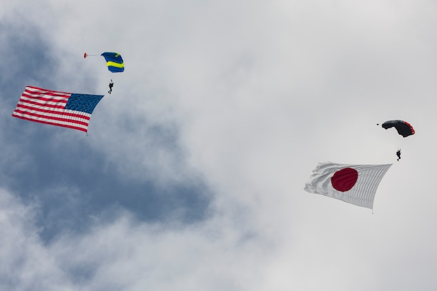 Evolve Aerosports executes a flag jump during the 41st Japan Maritime Self-Defense Force – Marine Corps Air Station Iwakuni Friendship Day at MCAS Iwakuni, Japan, May 5, 2017. Since 1973, MCAS Iwakuni has held a single-day air show designed to foster positive relationships and offer an elevating experience that displays the communal support between the U.S. and Japan. The air show also encompassed various U.S. and Japanese static aircraft displays, aerial performances and demonstrations, food and entertainment. (U.S. Marine Corps photo by Lance Cpl. Christian J. Robertson)