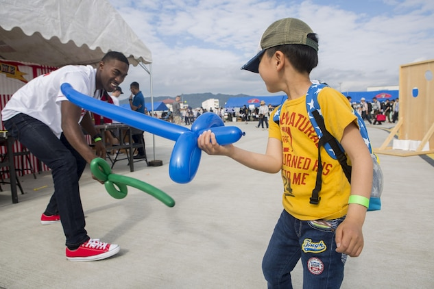 A Japanese local and a U.S. Marine use ballon swords to duel during the 41st Japan Maritime Self-Defense Force – Marine Corps Air Station Iwakuni Friendship Day at MCAS Iwakuni, Japan, May 5, 2017. Since 1973, MCAS Iwakuni has held a single-day air show designed to foster positive relationships and offer an elevating experience that displays the communal support between the U.S. and Japan. The air show also encompassed various U.S. and Japanese static aircraft displays, aerial performances and demonstrations, food and entertainment. (U.S. Marine Corps photo by Lance Cpl. Jesula Jeanlouis)
