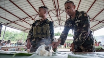 Philippine Soldiers prepare rice for a Boodle Fight at a disaster preparedness symposium during Balikatan 2017 in Ormoc City, Leyte, May 2, 2017. A Boodle Fight is a communal meal and Philippine military tradition to symbolize unity and camaraderie. The Armed Forces of the Philippines along with representatives from Japan Self-Defense Force, Australian Defence Force, and U.S. military worked with a local barangay to improve health conditions and disaster preparedness. Balikatan is an annual U.S.-Philippine bilateral military exercise focused on a variety of missions, including humanitarian assistance and disaster relief, counterterrorism, and other combined military operations.