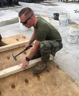 "On May 1, 2017 Second Lieutenant Andrew Shrader, a Marine attached to Combat Engineer Officer course 4-17 (CEO 4-17); nails 2"" x 4"" boards together to create a form used to facilitate concrete pouring. CEO students learn how to calculate concrete production during this course at Marine Corps Engineer School in Camp Lejeune, N.C."