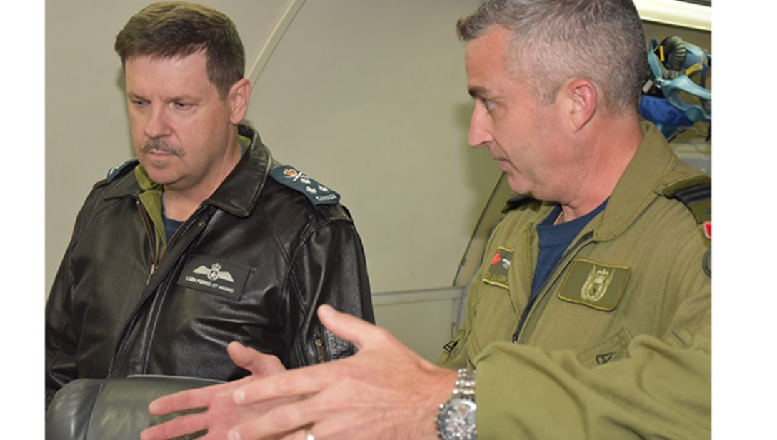 LCol Don Saunders, Commander, Canadian Detachment, explains Mission Crew Commander procedures to LGen Pierre St. Amand, Royal Canadian air force and Deputy Commander, North American Aerospace Defense Command, Peterson Air Force Base, Colo.  The general was the guest speaker at the Canadian Detachment's Mess Dining In held 21 Apr 17.   (Air Force photo by Ron Mullan)