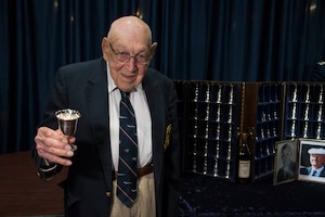 DAYTON, Ohio -- Lt. Col. (Ret.) Richard E. Cole, the sole surviving member of the Doolittle Tokyo Raiders toasts the fallen Raiders in a private ceremony at the National Museum of the U.S. Air Force on April 18, 2017. (U.S. Air Force photo by Ken LaRock)