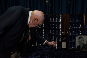 DAYTON, Ohio -- Lt. Col. (Ret.) Richard E. Cole, the sole surviving member of the Doolittle Tokyo Raiders, retired the goblet of Staff Sergeant David J. Thatcher in a private ceremony at the National Museum of the U.S. Air Force on April 18, 2017. (U.S. Air Force photo by Ken LaRock)