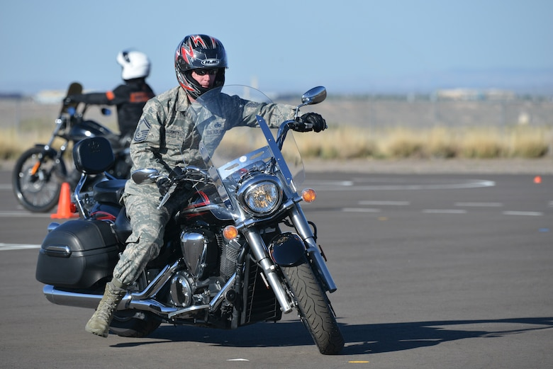 Senior Master Sgt. Neil McLuskey, 898th Munitions Squadron, demonstrates his riding skills during the Motorcycle Safety Foundation's basic rider course. The course is free and required by the Air Force for anyone wishing to ride on base. To sign up for a Rider Course, go to https://sites.google.com/site/kafbriders.