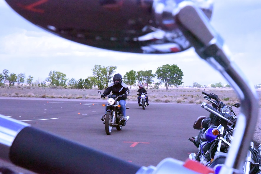Senior Airman Chandler Baker (left) and Charles Alvey practice shifting from first to second gear during the basic rider course, April 27. The practical application portion of the course consists of 14 exercises and a skills test. The course is free and required by the Air Force for anyone wishing to ride on base. To sign up for a Rider Course, go to https://sites.google.com/site/kafbriders.