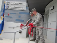 Lt. Col. Jarrod Norris, 836th Cyberspace Operations Squadron Commander, and Lt. Colonel Travis Howell, 833rd COS Commander, cut the ribbon for the newly-renovated Building 390 April 14 on Medina Annex, San Antonio, Texas. The new 836/833 COS headquarters is the first building in the Air Force solely dedicated to cyber mission forces. (Courtesy photo)