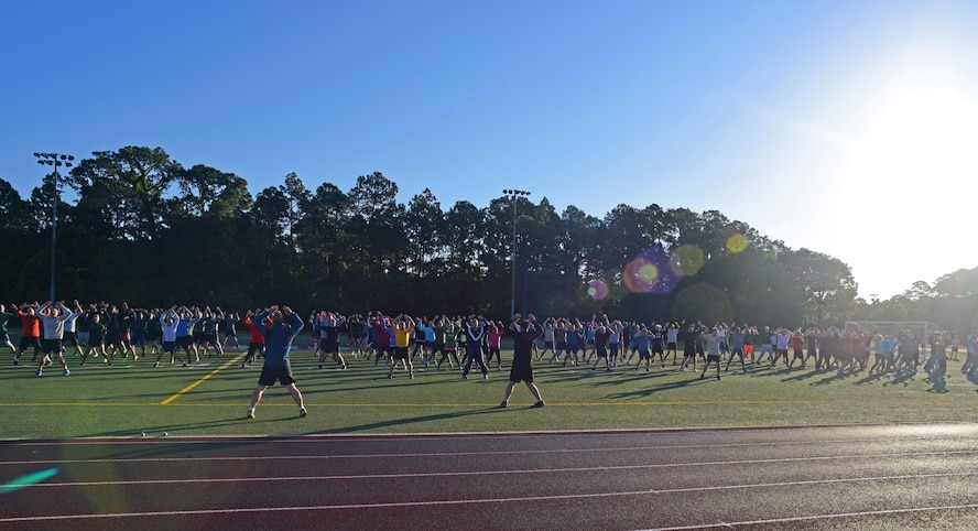 The Headquarters Air Force Special Operations Command staff warms up for a 5K run at Hurlburt Field, Fla., May 5, 2017. These Air Commandos meet once a month to work out together. (U.S. Air Force photo/Staff Sgt. Melanie Holochwost)