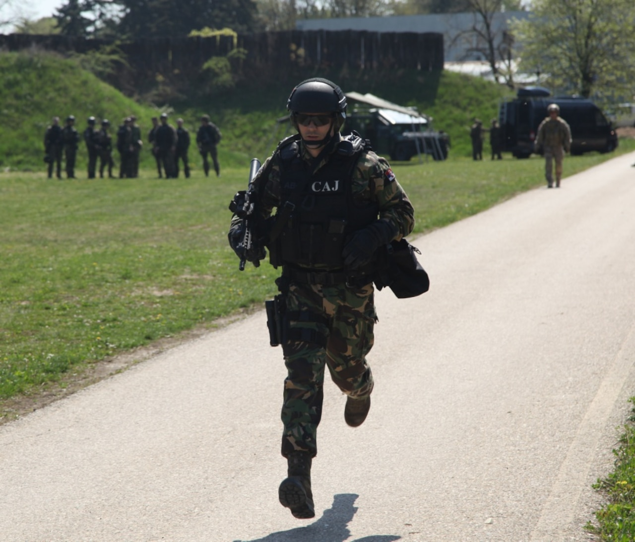 A Serbian special anti-terrorist unit officer runs to the first station of a shooting exercise during joint  combined exchange training with U.S. and Slovenian special operation forces at the SAJ headquarters complex in Serbia, April 10, 2017. The Serbian unit, known as the SAJ, serves as a special operations and tactical unit of the Serbian police and will receive training in a variety of tactics and techniques over the course of the JCET to increase their effectiveness in future operations. Army photo by Spc. Simeon Trombitus