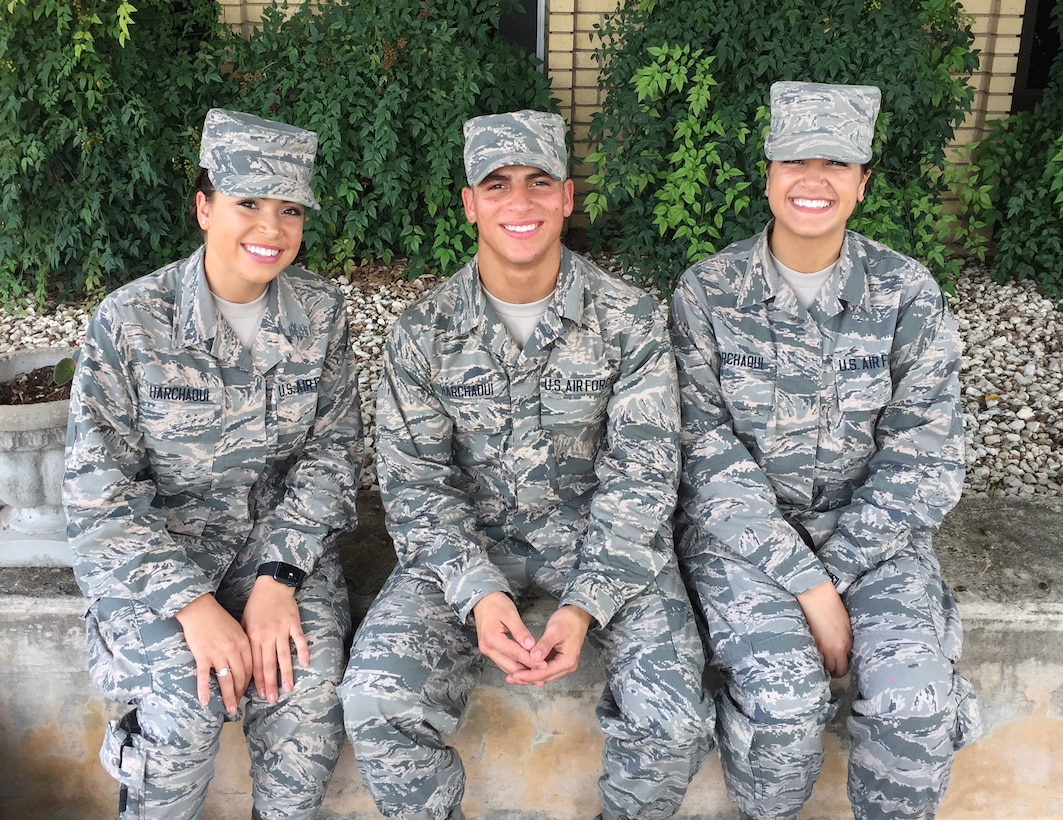 Pictured are the Harchaoui triplets (from left): Myriam, 436th Supply Chain Operations Squadron at Scott Air Force Base, Ill.; Rabah, 56th Security Forces Squadron at Luke AFB, Ariz.; and Warda, 60th Medical Operations Squadron at Travis AFB, Calif. All three were born in Algeria before immigrating to the United States, and are Airmen serving in today's Air Force. (Courtesy photo)