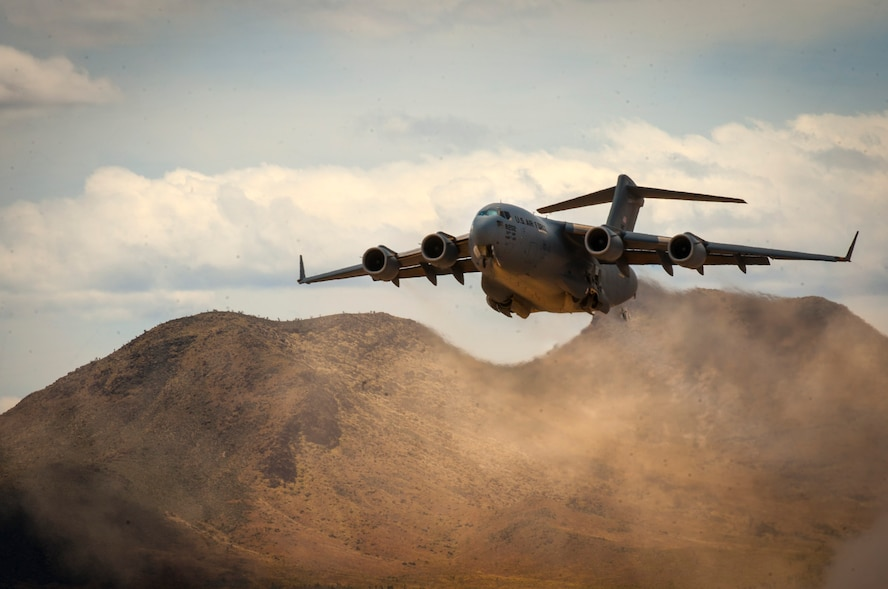 A C-17 Globemaster III cargo aircraft assigned to the 57th Weapons Squadron, U.S. Air Force Weapons School, Nellis Air Force Base, Nev., takes off from a dry lake bed during a composite mission application exercise at the Nevada Test and Training Range, April 24, 2017. The training scenario required an aeromedical evacuation of a combat casualty via a C-17. (U.S. Air Force photo by Senior Airman Joshua Kleinholz/Released)