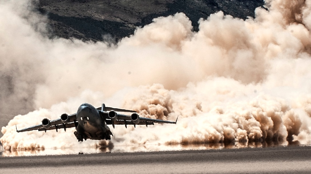 A C-17 Globemaster III cargo aircraft, assigned to the 57th Weapons Squadron, U.S. Air Force Weapons School, Nellis Air Force Base, Nev., takes off from a dry lake bed during a composite mission application exercise on the Nevada Test and Training Range. Several U.S. Air Force aircraft can operate in austere conditions, allowing for rapid medical evacuations and the establishment of improvised forward refueling points. (U.S. Air Force photo by Senior Airman Joshua Kleinholz/Released)