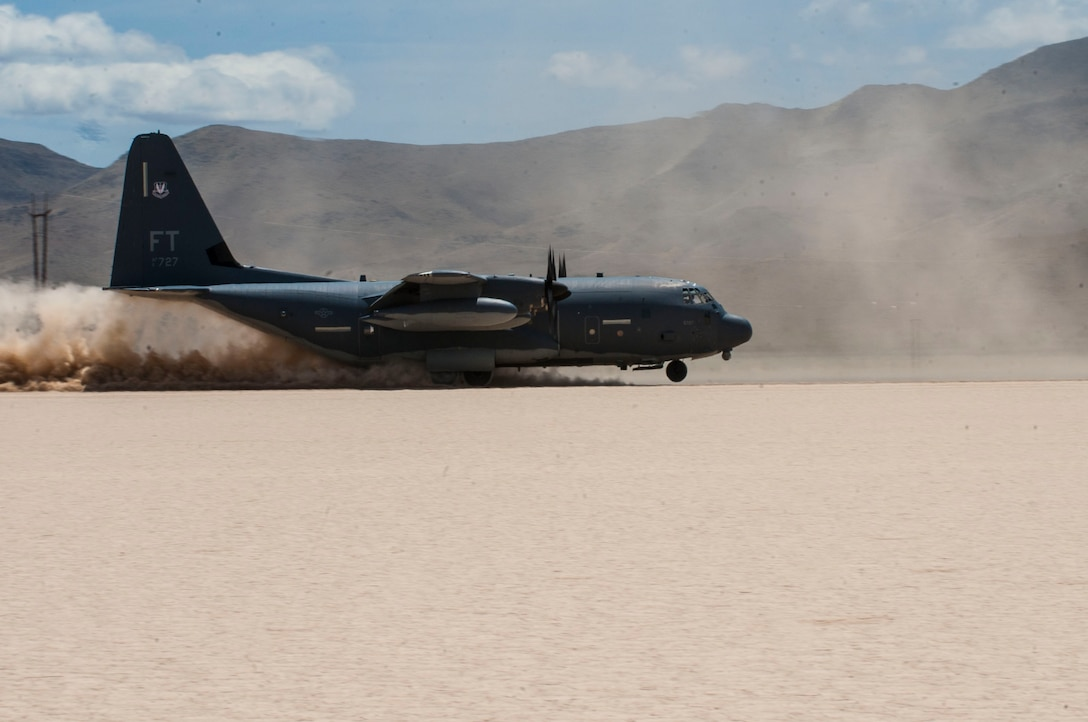 An HC-130P/N King cargo aircraft assigned to the 34th Weapons Squadron, U.S. Air Force Weapons School, Nellis Air Force Base, Nev., lands on a dry lake bed during a composite mission application exercise at the Nevada Test and Training Range, April 24, 2017. The HC-130P/N is an extended-range version of the C-130 Hercules transport. HC-130 crews provide expeditionary, all-weather personnel recovery capabilities to combatant commanders and joint/coalitions partners worldwide. (U.S. Air Force photo by Senior Airman Joshua Kleinholz/Released)