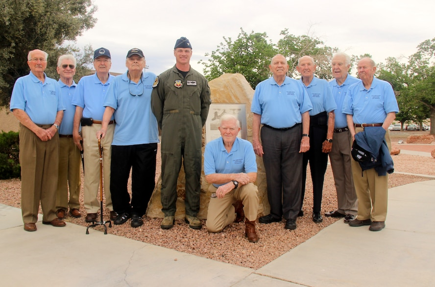 Members of the F-86 Sabre Association pose for a photo with Col. Michael Drowley, U.S. Air Force Weapons School commandant on Nellis Air Force Base, Nev., April 7, 2017. The F-86 Sabre Association met April 24 on the flightline here to pay homage to the retired jet and the Airmen who flew it for the last time. (U.S. Air Force photo by Susan Garcia/Released)