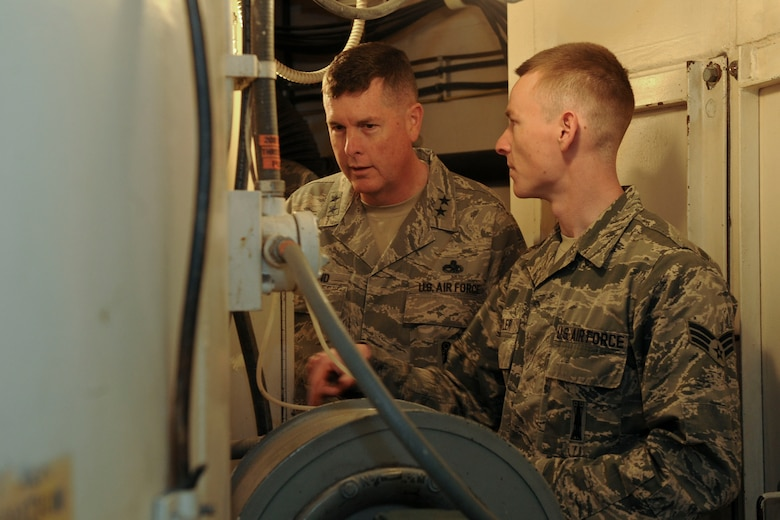 Senior Airman Jamie Oyler, 91st Missile Maintenance Squadron facilities maintenance team team chief, explains launch tube temperature to Maj. Gen. Gene Kirkland, Air Force Material Command director of logistics, civil engineering and force protection, at Minot Air Force Base, N.D., Apr. 28, 2017. Kirkland visited to discuss logistics with 5th Bomb Wing and 91st Missile Wing Airmen and speak at the 91st Maintenance Group Maintenance Professional of the Year banquet. (U.S. Air Force photo/Airman 1st Class Jessica Weissman)