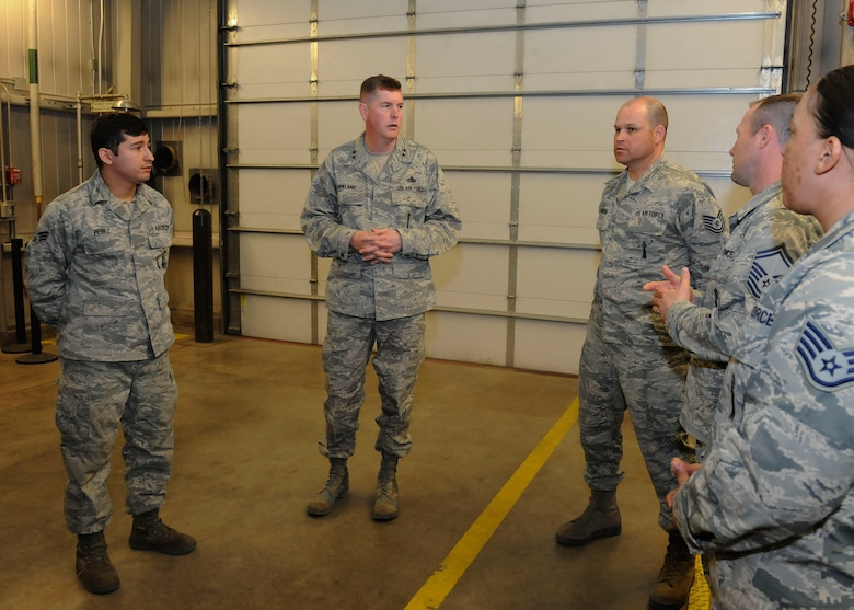 Maj. Gen. Gene Kirkland, Air Force Material Command director of logistics, civil engineering and force protection, talks with Airmen at Minot Air Force Base, N.D., Apr. 28, 2017. Kirkland visited to discuss logistics 5th Bomb Wing and 91st Missile Wing Airmen and speak at the 91st Maintenance Group Maintenance Professional of the Year banquet. (U.S. Air Force photo/Airman 1st Class Jessica Weissman)