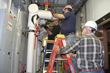 HANOVER, New Hampshire – USACE Public Works air conditioning technicians John Adams (left), Jim Crary (center), and Mike Sadonsky (right) remove air conditioning components from CRREL's Cold Room Complex here May 3. Preparation work is on schedule for the partial infrastructure upgrade of the 50+ year-old facility that provides controlled environmental conditions down to -35C (-30F) degrees. The $750+K project (Section 219 / Operation & Maintenance funded) replaces nine of the 24-rooms with four stand-alone structures that will provide improved energy efficiency; and more accurate temperature control capability. The project is expected to be completed by the end of the FY 2017.