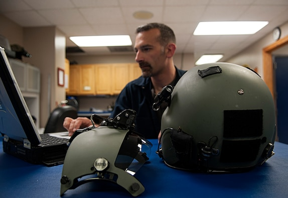 Brian Amitrano, 54th Helicopter Squadron aircrew flight equipment member, searches equipment data at Minot Air Force Base, N.D., May 2, 2017. The unit's maintainers fix and inspect flying and training equipment for aircrew, to include helmets and night vision goggles. (U.S. Air Force photo/Airman 1st Class Jonathan McElderry)