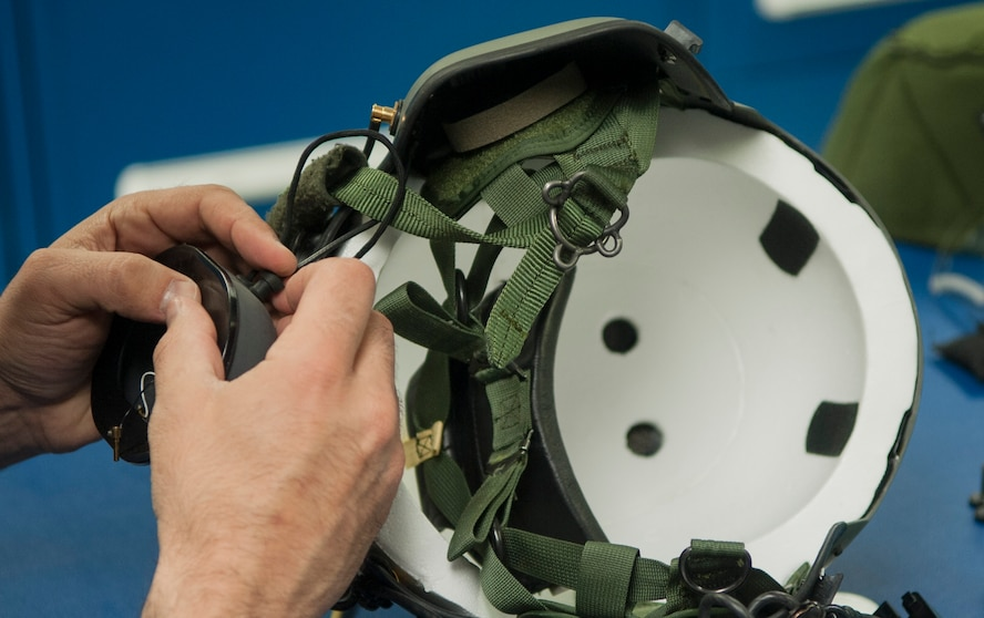 A member of the 54th Helicopter Squadron aircrew flight equipment section, installs ear protection on a helmet at Minot Air Force Base, N.D., May 2, 2017. The unit's maintainers perform aircraft maintenance as well as inspect and manage various pieces of aircrew flight equipment. (U.S. Air Force photo/Airman 1st Class Jonathan McElderry)