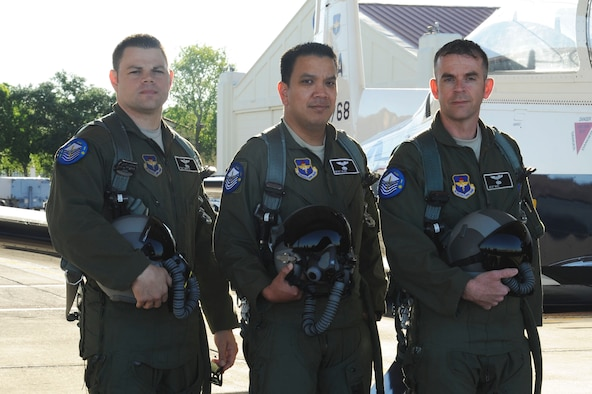 Tech. Sgt. Mike, Master Sgt. Alex and Master Sgt. Mike stand next to a T-6A Texan II parked on the flightline at Joint Base San Antonio-Randolph, Texas, May 4, 2017. They completed undergraduate remotely piloted aircraft training May 5 and are the first Air Force enlisted Airmen to train as pilots since World War II. Master Sgt. Mike was a distinguished graduate in the URT class of 20 including 17 commissioned officers. (U.S. Air Force illustration/Tech. Sgt. Ave I. Young)
