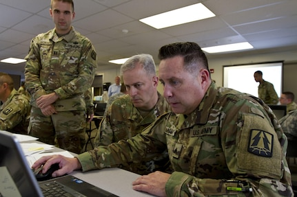Sgt. Charles Apperti, a U.S. Army Reserve information technology specialist assigned to the Army Reserve Cyber Operations Group, Western Cyber Protection Center out of Camp Parks, Ca., shows Col. Michael D. Smith, commander for the Army Reserve Cyber Operations Group out of Adelphi, Md., his work during Cyber Shield 17 at Camp Williams, Utah, May 2, 2017. Cyber Shield is a National Guard exercise, in cooperation with U.S. Army Reserve, that provides Soldiers, Airmen and civilians from over 44 states and territories the opportunity to test their skills in response to cyber-incidents in a multi-service environment. (U.S. Army Reserve photo by Sgt. Stephanie Ramirez)