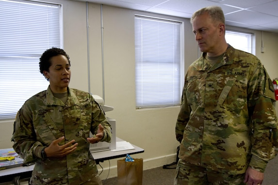 Maj. Ambyr Leidig, a U.S. Army Reserve Soldier assigned to the Army Reserve Cyber Operations Group, Western Cyber Protection Center out of Camp Parks, Ca., briefs Col. Michael D. Smith, commander for the Army Reserve Cyber Operations Group out of Adelphi, Md., during Cyber Shield 17 at Camp Williams, Utah, May 2, 2017. Cyber Shield is a National Guard exercise, in cooperation with U.S. Army Reserve, that provides Soldiers, Airmen and civilians from over 44 states and territories the opportunity to test their skills in response to cyber-incidents in a multi-service environment. (U.S. Army Reserve photo by Sgt. Stephanie Ramirez)