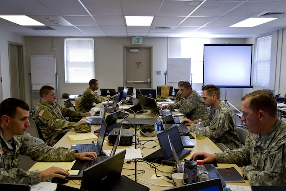 A group of U.S. Army Reserve and National Guard cyber Soldiers work together to defend their network during Cyber Shield 17 at Camp Williams, Utah, May 2, 2017. Cyber Shield is a National Guard exercise, in cooperation with U.S. Army Reserve, that provides Soldiers, Airmen and civilians from over 44 states and territories the opportunity to test their skills in response to cyber-incidents in a multi-service environment. (U.S. Army Reserve photo by Sgt. Stephanie Ramirez)