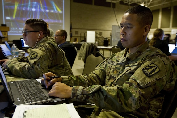 Maj. Lavon Hooker, a U.S. Army Reserve cyber planner assigned to the 335th Signal Command (Theater) out of East Point, Ga., protects the network during Cyber Shield 17 at Camp Williams, Utah, May 2, 2017. Cyber Shield is a National Guard exercise, in cooperation with U.S. Army Reserve, that provides Soldiers, Airmen and civilians from over 44 states and territories the opportunity to test their skills in response to cyber-incidents in a multi-service environment. (U.S. Army Reserve photo by Sgt. Stephanie Ramirez)