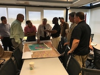 Elmo Web (center), Little Rock District levee safety program manager, talks levee safety with individuals associated with the Fourche Island and Woodson levees near Little Rock, Ark.