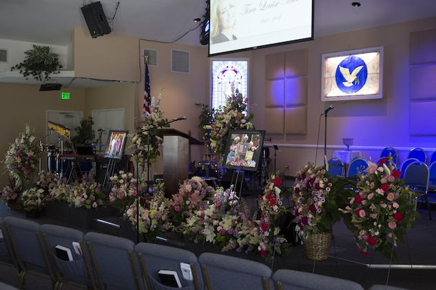 Flowers decorated the Valley Community Chapel alter area before at a celebration of life for Tina Miller, former deputy director of the Combat Center Performance and Innovation Office, in Yucca Valley, Calif., April 29, 2017. (U.S. Marine Corps photo by Cpl. Thomas Mudd)