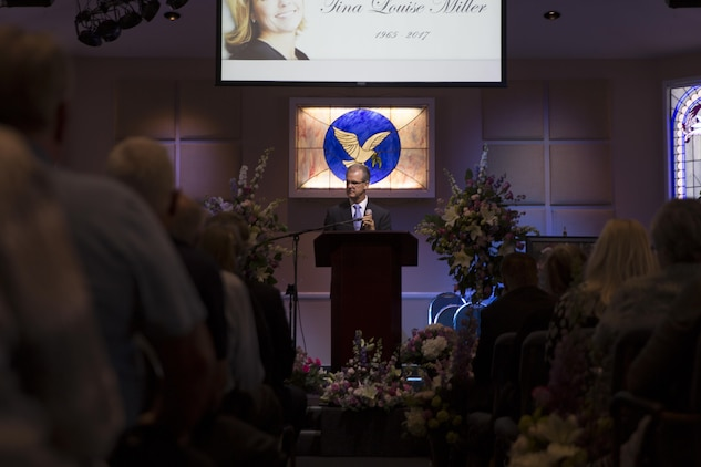 Mark Miller, husband of Tina Miller, former deputy, Combat Center Performance and Innovation Office, addresses friends and family during a celebration of life at Valley Community Chapel in Yucca Valley, Calif., in honor of Tina, April 29, 2017. (U.S. Marine Corps photo by Cpl. Thomas Mudd)