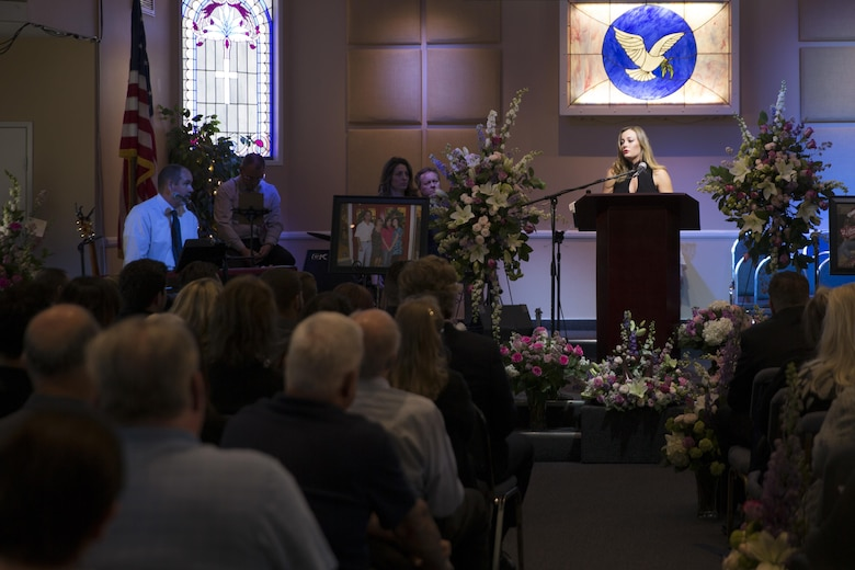 Valerie Kimball, daughter of Tina Miller, former deputy, Combat Center Performance and Innovation Office, talks about the lessons she learned from her mother during a celebration of life held at Valley Community Chapel in Yucca Valley, Calif., in honor of Tina, April 29, 2017. (U.S. Marine Corps photo by Cpl. Thomas Mudd)
