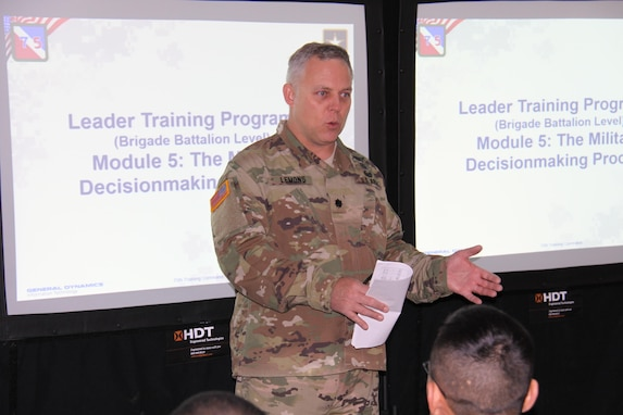 "Lt. Col. Tim Lemons, of 1st Brigade, Great Lakes Training Division, 75th Training Command, begins a block of instruction on the Military Decision Making Process, as part of the ""warm start"" of WAREX 86-17-02 at Ft. McCoy, Wisconsin. Lemons serves as Chief Observer Controller/Trainer of the OC/T team attached to the 457th Transportation Battalion, of Ft. Snelling, Minnesota, during WAREX 86-17-02."