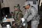 Capt. Anselmo Lizama, a digital master gunner for 1st Brigade, Great Lakes Training Division, 75th Training Command, instructs a Soldier in the 419th Combat Services Support Battalion on the Mission Command Work Station. Lizama, who hails from Guam, serves on the GLTD observer controller/trainer team assigned to the 419th CSSB during WAREX 86-17-02. The ongoing WAREX is being conducted at Ft. McCoy, Wisconsin. The 419th CSSB is headquartered in Tustin, California.