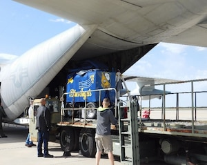 DLA Distribution Corpus Christi, Texas' Airlift Crew uses a 40,000 Loader to offload Blue Angels support equipment from the team's C-130.