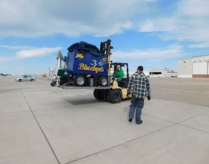 DLA Distribution Corpus Christi employees transport support equipment for the Blue Angels.