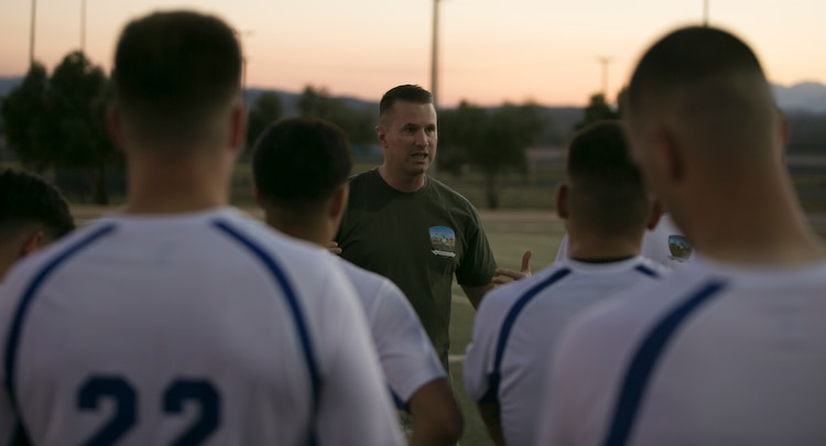 Navy Lt. Richard Schaffer, head coach, Headquarters Battalion soccer team, gives his players pointers during an intramural soccer game against the Marine Corps Communication-Electronics School team at Felix Field aboard Marine Corps Air Ground Combat Center, Twentynine Palms, Calif., May 1, 2017. Marine Corps Community Services, in partnership with Semper Fit, hosts an intramural soccer league for units aboard the installation. HQBN came out victorious with a score of 3-1. (U.S. Marine Corps photo by Cpl. Medina Ayala-Lo)