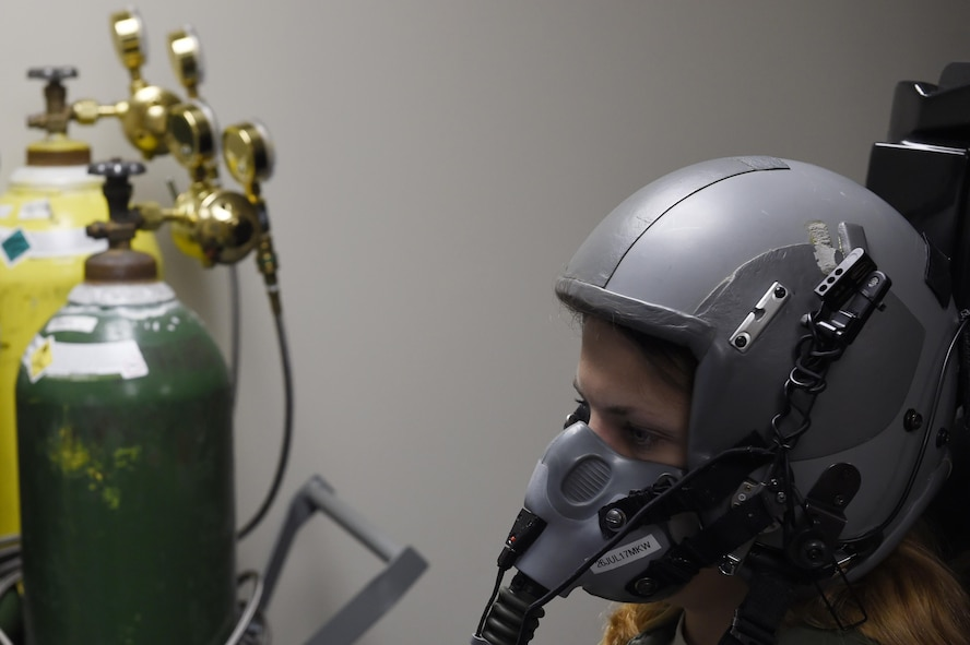 Staff Sgt. Katherine Stanton, 15th Airlift Squadron loadmaster, completes one-on-one hypoxia training in the Reduced Oxygen Breathing Device and Hypoxia Familiarization Trainer. For the training, Airmen fly a C-17 flight task simulation as the ROBD precisely mixes nitrogen and reduced oxygen to equivalent oxygen concentrations at higher altitudes. This allows Airmen to see how hypoxia affects their motor skills and to experience their symptoms in a low risk environment.
